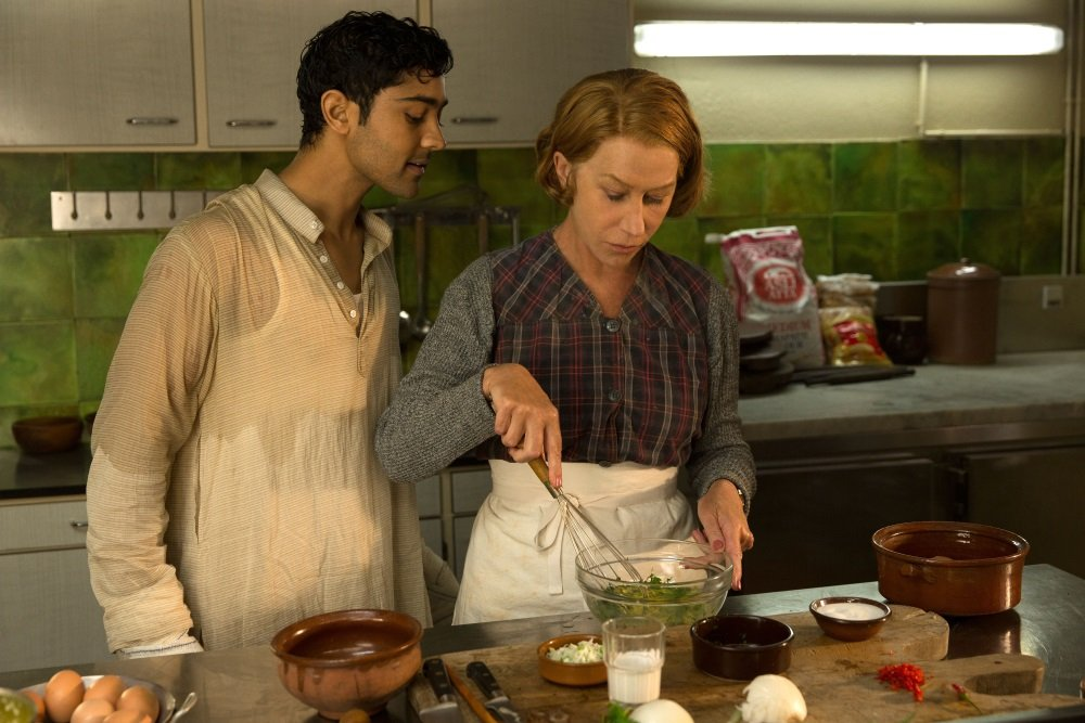 "When Hassan Kadam (Manish Dayal) and his family move from India to a village in the South of France, they open a restaurant and encounter Madame Mallory, (Academy Award®-winner Helen Mirren) the chef proprietress of a classical Michelin-starred French restaurant across the street. Cultures collide, but they eventually find common ground through their love of cooking, in DreamWorks Pictures' charming film, ""The Hundred-Foot Journey."" Based on the novel ""The Hundred-Foot Journey"" by Richard C. Morais, the film is directed by Lasse Hallström. The producers are Steven Spielberg, Oprah Winfrey and Juliet Blake. Photo: François Duhamel ©2014 DreamWorks II Distribution Co., LLC. All Rights Reserved."