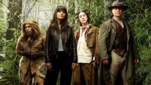 Zooey Deschanel, Raoul Trujillo, Alan Cumming, and Neal McDonough in a revisionist Oz