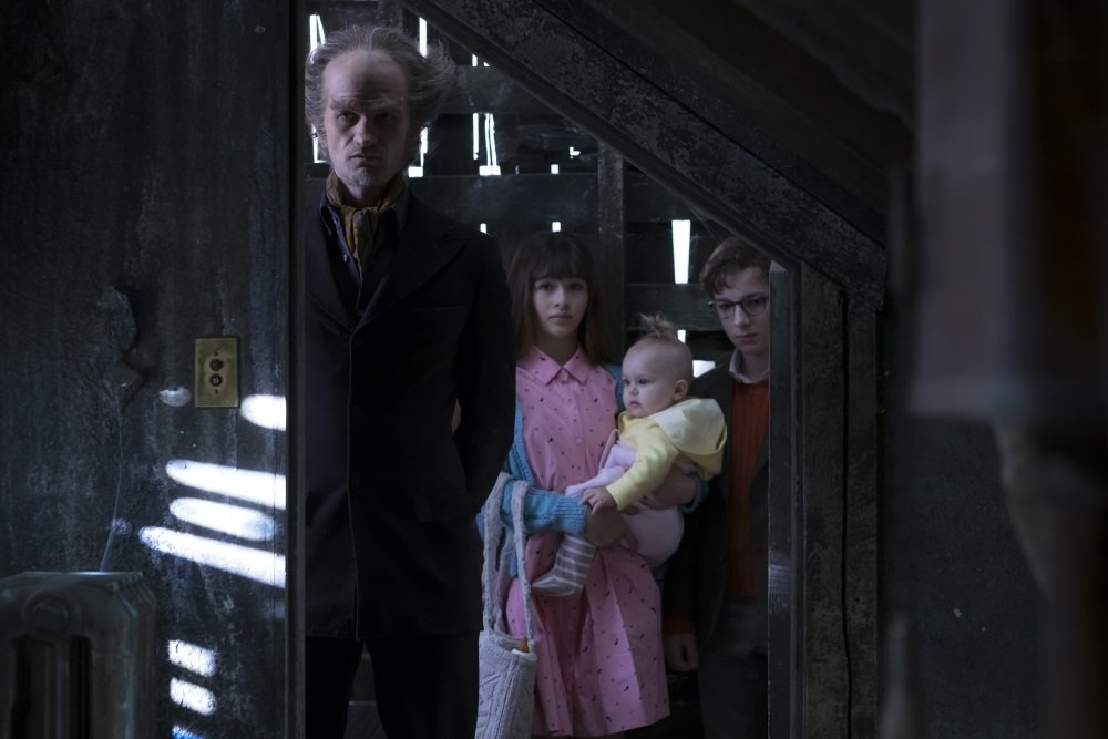 "Neil Patrick Harris, Malina Weissman, and Louis Hynes in ""A Series of Unfortunate Events."""