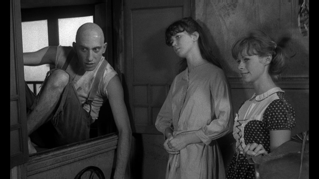 Sid Haig, Jill Banner, and Beverly Washburn star in Jack Hill's cult classic