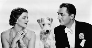 Myrna Loy and William Powell (with Asta) as Nick and Nora Charles in the great mystery series