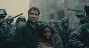 Clive Owen and Clare-Hope Ashitey star in the science fiction drama directed by Alfonso Cuaron