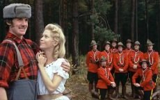 Michael Palin, Carol Cleveland, and the group in 'The Lumberjack Song'