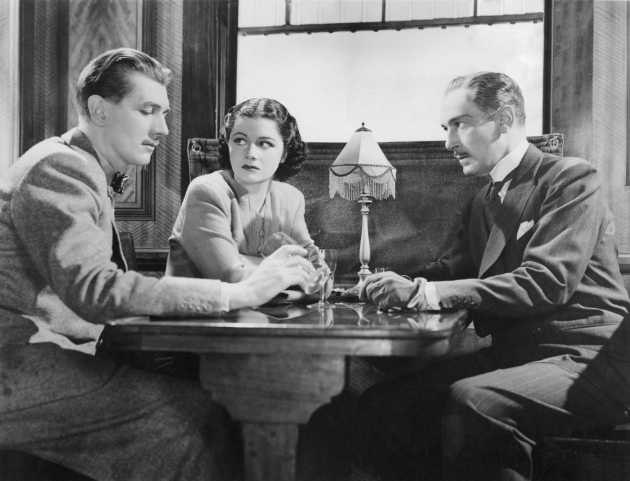 Michael Redgrave, Margaret Lockwood, and Paul Lukas in Alfred Hitchcock's The Lady Vanishes