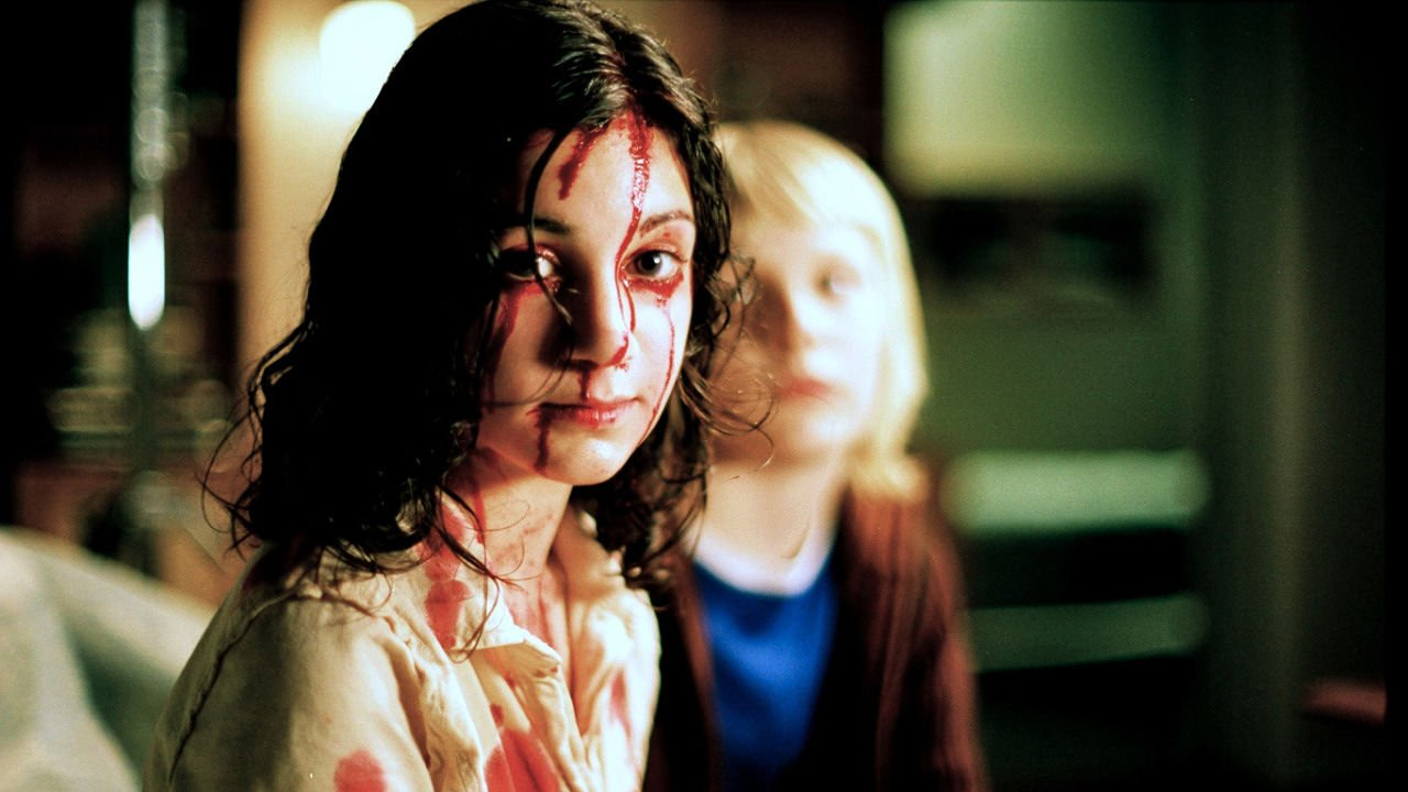 Lina Leandersson and Kare Hedebrant in Tomas Alfredson's Swedish vampire film / young love horror piece 'Let the Right One In '