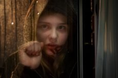 Chloë Grace Moretz stars in the American remake of the Swedish horror film, directed by Kodi Smit-McPhee