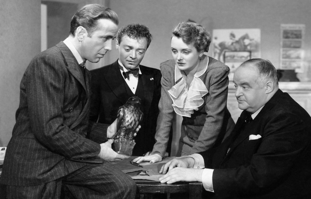Humphrey Bogart, Peter Lorre, Mary Astor, and Sydney Greenstreet in the film adapted from the Dashiell Hammett novel by John Huston.